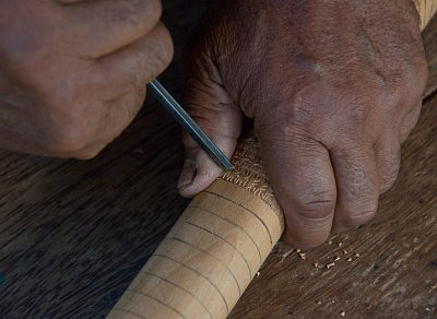Carving the handle of the Mangaian adze
