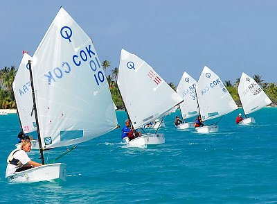 Optimist yachts competing on Aitutaki's Lagoon